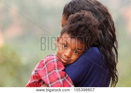 Child Hugging Mother