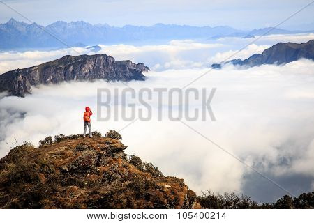 Young Woman Photographer Taking Photo For Beautiful Landscape On Mountain Peak