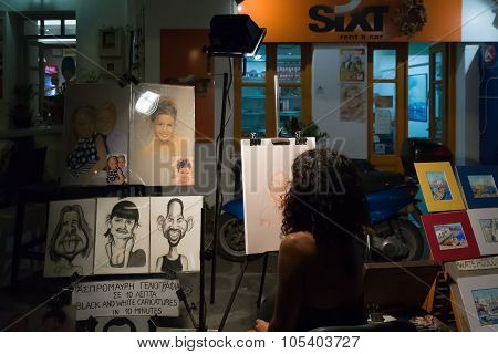 Paros, Greece, 8 August 2015. Street artist making portraits of local people and tourists in Paros