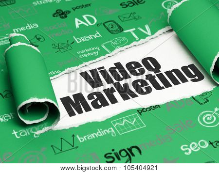 Advertising concept: black text Video Marketing under the piece of  torn paper