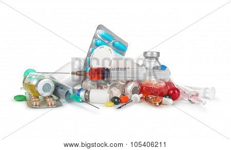 Heap Of Medical Syringes, Bottles, Pills, Ampules Isolated On White