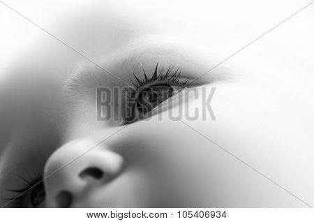 Close-up of little baby eye after crying