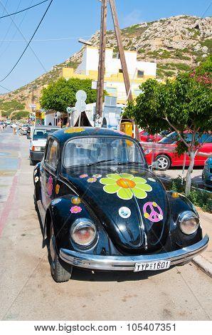 MATALA, CRETE - JULY 22: Volkswagen beetle in Matala village on July 22,2014 on the island of Crete.