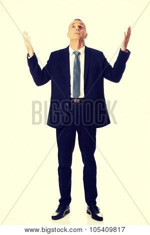 Mature businessman with hands open gesture.