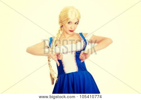 Woman wearing traditional Bavarian dress with thumbs down.