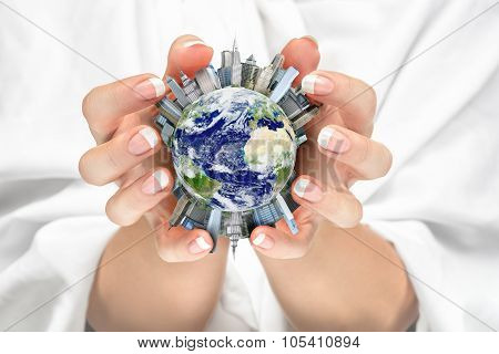 Women Cradling The Earth City In Her Hands