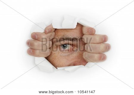 Man Looks Out A Hole In White Wall
