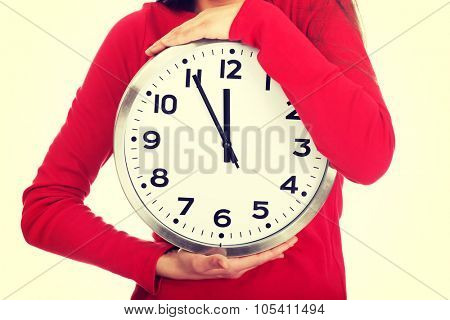 Young student woman with the clock.