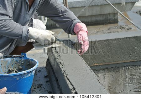 Pebble wash works by construction workers  SELANGOR, MALAYSIA - DECEMBER 05, 2014: Pebble wash works