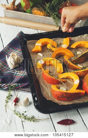 Prepearing Pumpking For Roasted Into The Oven