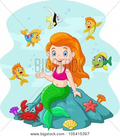 Happy little mermaid sitting on the rock surrounded by fishes