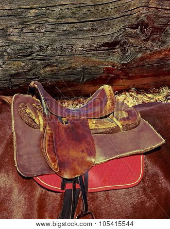 Brown Horse Ridding Saddle On Log Wall Background.