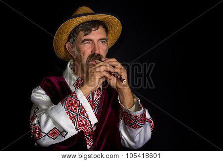 Portrait of Ukrainian farmer with sopilka