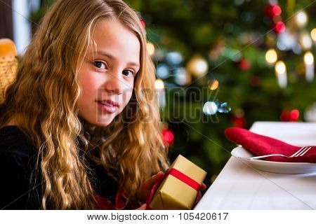 Girl with Christmas gift on boxing day