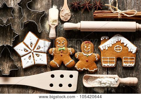 Kitchen utensils and ingredients for christmas homemade gingerbread cookies on wooden table