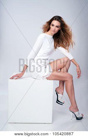 Full length fashion model in gorgeous dress