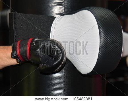 Black Boxing Glove Striking White Punching Bag In Fitness Class