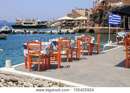 Greek Tavern With Orange Wooden Chairs, Santorini , Greece
