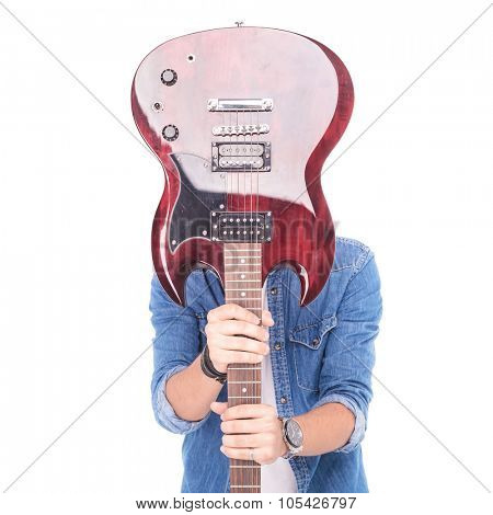 casual guitarist holding guitar over his face, on white background