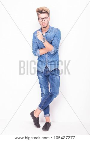 full body of a serious casual man wearing jeans clothes on white background