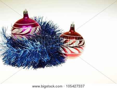 Christmas Composition With Two Christmas Baubles And Blu Chain