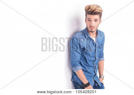 cool dude in casual jeans clothes looking at the camera on white background