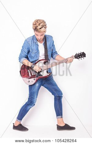 full body picture of a guitarist playing his instrument on white background