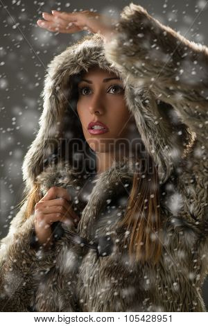 Girl Finding Her Way Through Blizzard