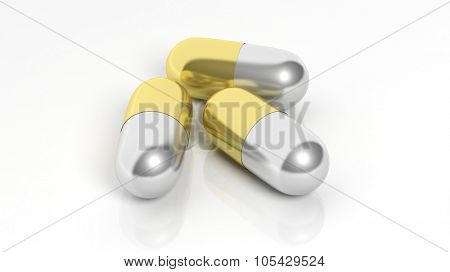 Gold and silver caplets, isolated on white background.