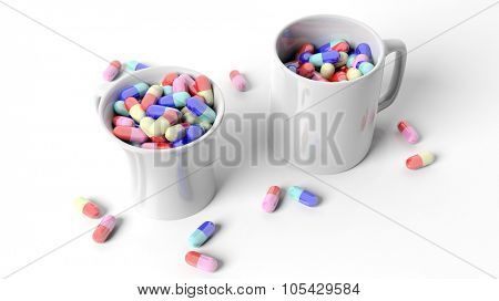Coffee mugs full of pills,isolated on white background.