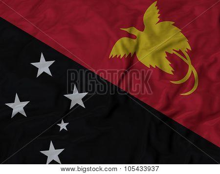 Closeup of ruffled Papua New Guinea flag