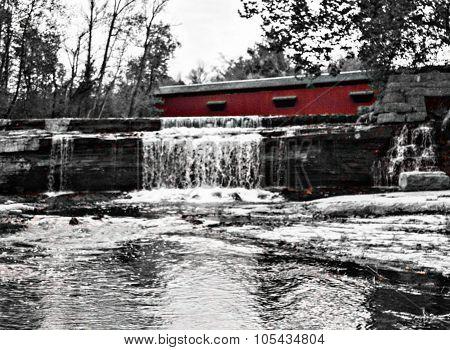 Red bridge, waterfall, fall season