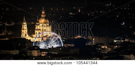 night view on Cupola and ferris wheel in Budapest