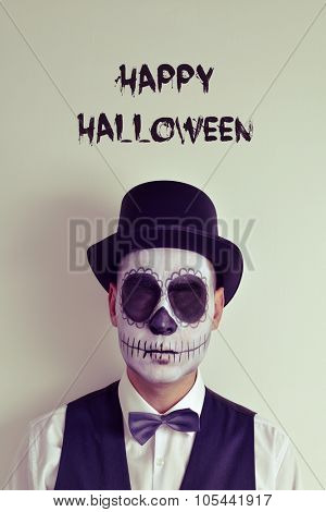 portrait of a man with calaveras makeup without eyes, wearing bow tie and top hat, and the text happy halloween