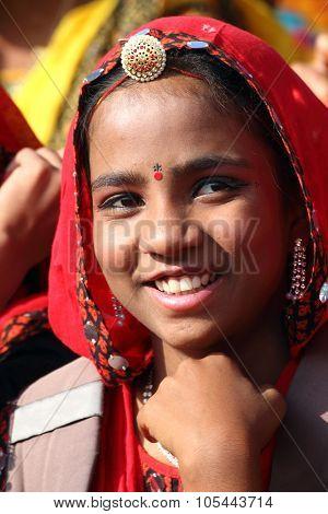 PUSHKAR, INDIA - NOVEMBER 21: Portrait of Indian girl in colorful ethnic attire at Pushkar camel fair on November 21, 2012 in Pushkar, Rajasthan, India.
