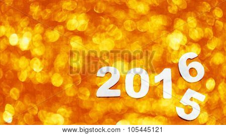 Number with 2016 on orange  bokeh background, new year template