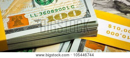 Creative business finance making money concept - letterbox panoramic image of new 100 US dollars 2013 edition banknotes (bills) bundles close up