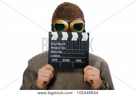 Pilot holding movie clapboard on white