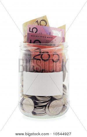 Coins And Banknotes In Glass Jar