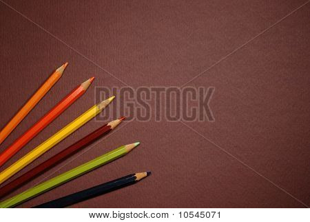 Empty Brown Cardboard Background And Coloured Pencils - Art Utensil