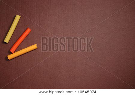 Empty Brown Cardboard Background And Multicolored Pastel - Art Utensil