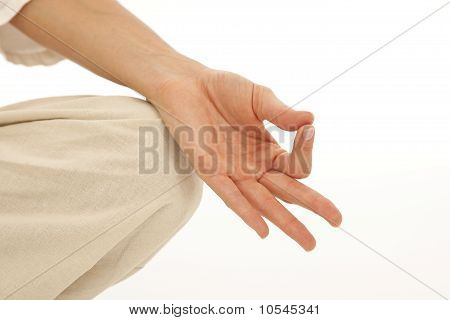 Close up of hands of young woman doing yoga