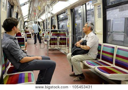PARIS - AUGUST 10, 2015: people in Paris Metropolitain train. The Paris Metro or Metropolitain is a rapid transit system in the Paris Metropolitan Area