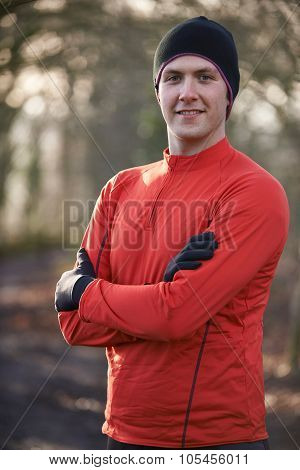 Portrait Of Man On Winter Run Through Woodland
