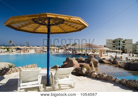 Parasol And Chaise-Longue