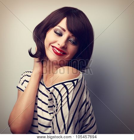 Beautiful Happy Young Woman With Short Hair Looking Down. Vintage Portrait