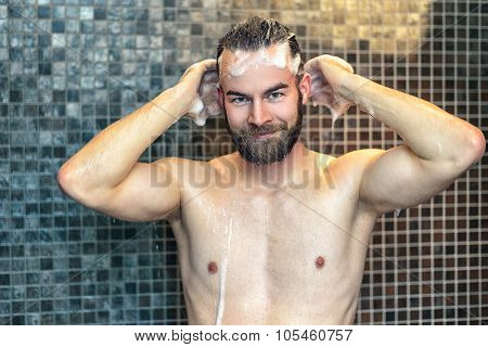 Bearded Man Washing His Hair With Shampoo