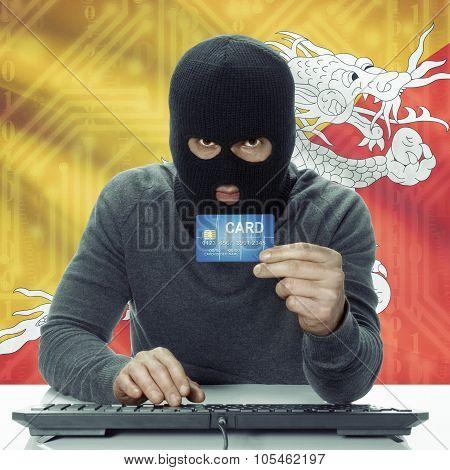 Dark-skinned Hacker With Flag On Background Holding Credit Card - Bhutan