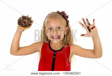 Beautiful Female Child With Blue Eyes In Cute Red Dress Eating Chocolate Donut With Syrup Stains