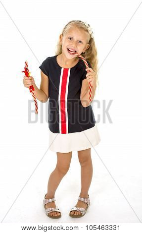 Beautiful Little Female Child With Blue Eyes Eating Strawberry Licorice Candy